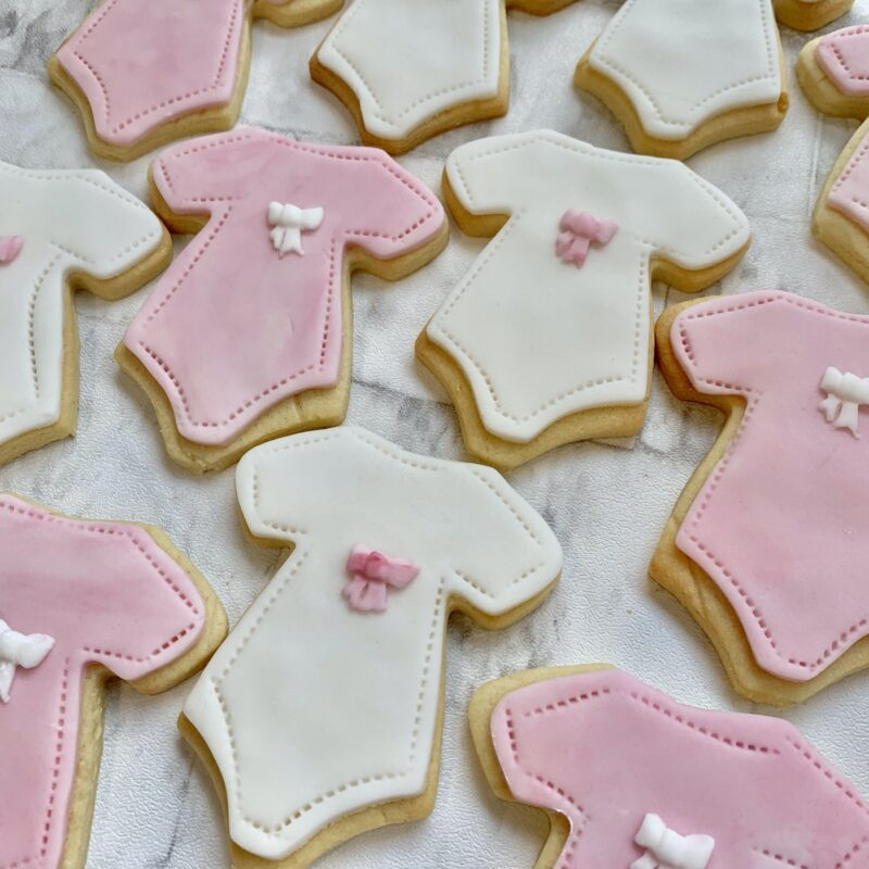 Baby Shower Biscuits from Enchanting Bakes. Babygro design.